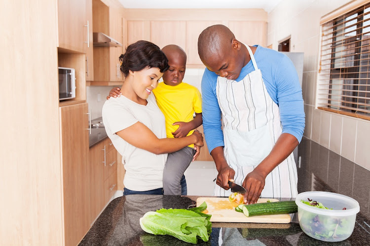 Getting kids involved in the kitchen is one way to help set healthy food habits in childhood.