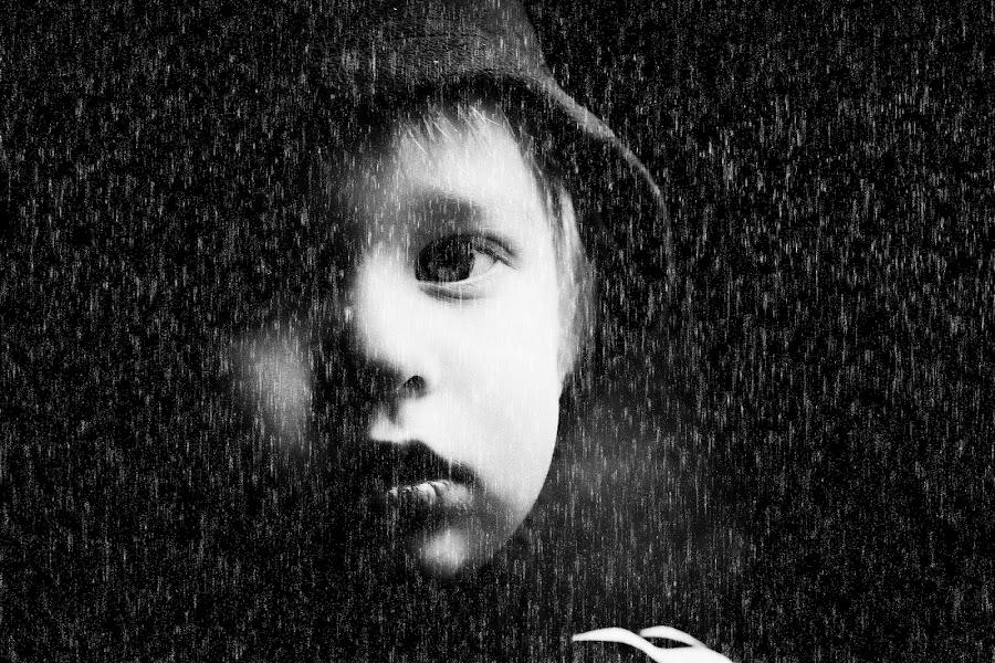 boy by Roz Batten - Babies & Children Child Portraits ( face, black & white, mood, people, rain,  )