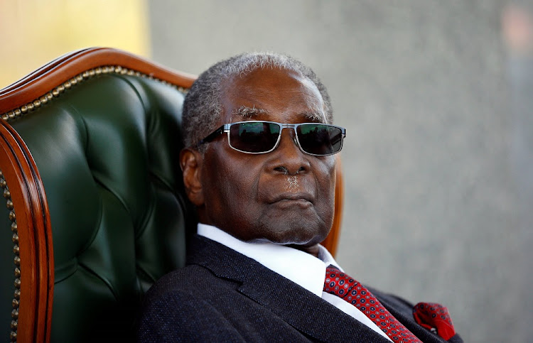 "Zimbabwe's former president Robert Mugabe looks on during a press conference at his private residence nicknamed ""Blue Roof"" in Harare, Zimbabwe, July 29, 2018."