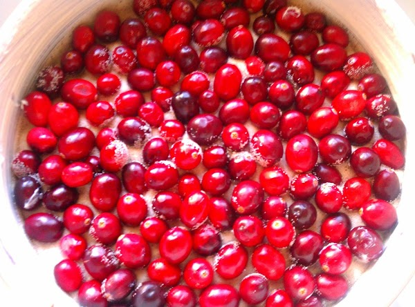 Add cranberries, in a single layer (as much as possible) on top of the...