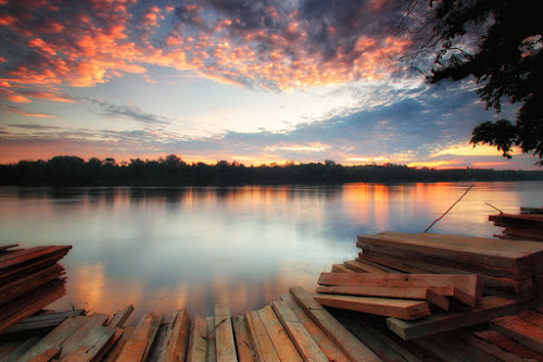 Kapuas River Over Sunset by Kosmas Fikie Aryadi - Landscapes Waterscapes