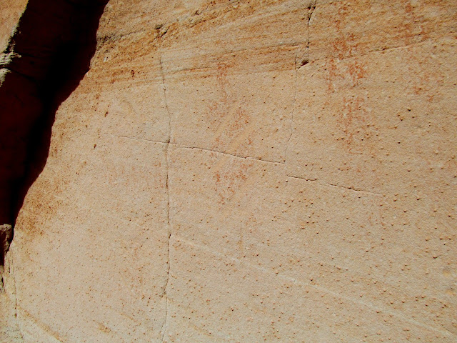Faint pictograph with abraded diagonal lines