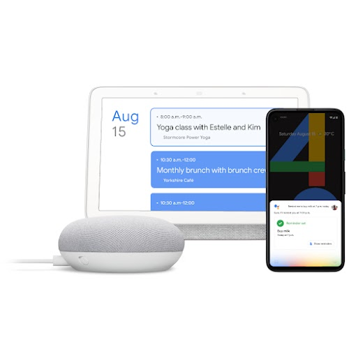 A Google Home, laptop and phone featuring Hey Google