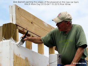 Photo: Bob Barnett painting the edges of the plywood on the new car barn.    HALS Work Day 2015-0411 © 2015 Rick White