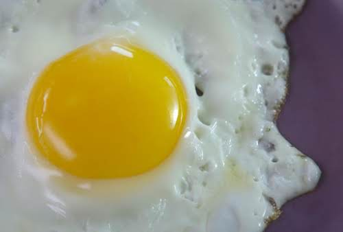 By shaking the pan or using a spatula, gently move egg around...