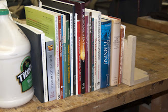 Photo: Our Turning Library contains these books that are available for checking out at every meeting.  Take a look next time and pick one to read.