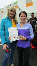 Photo: Siobhan Hoare, the first woman to finish the Challenge at 2:20pm is presented with her certificate by Breda Ryan.