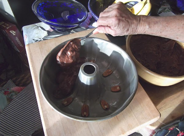 Pour into prepared cake pan, being careful not to disturb the sleeping pecans.