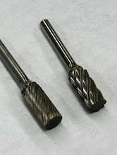 "Photo: Carbide rotary carving burrs -- a standard ""spiral cut"" burr on the left, and the much more expensive (and capable) ""Aluma-cut"" burr on the right -- ..."