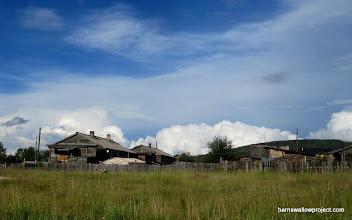 Photo: Clouds bursting from a village horizon at sundown