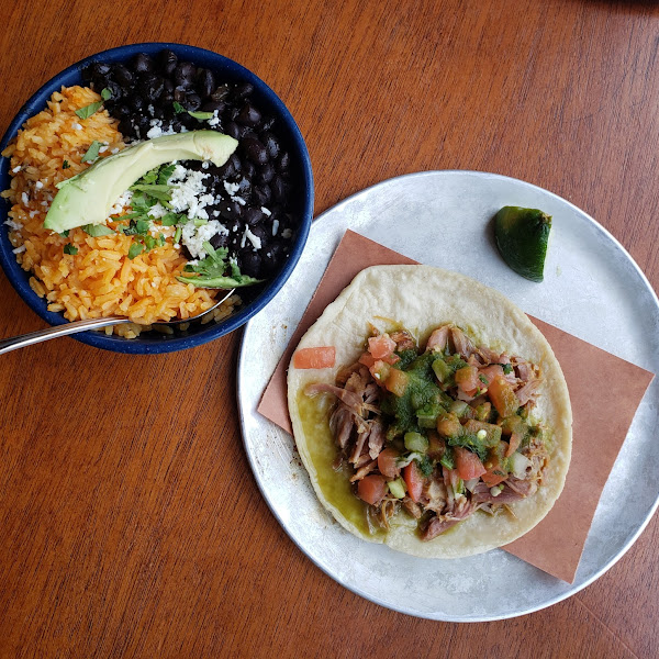 Carnitas taco & side of rice and beans