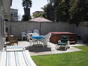 Photo: Back yard with jacuzzi