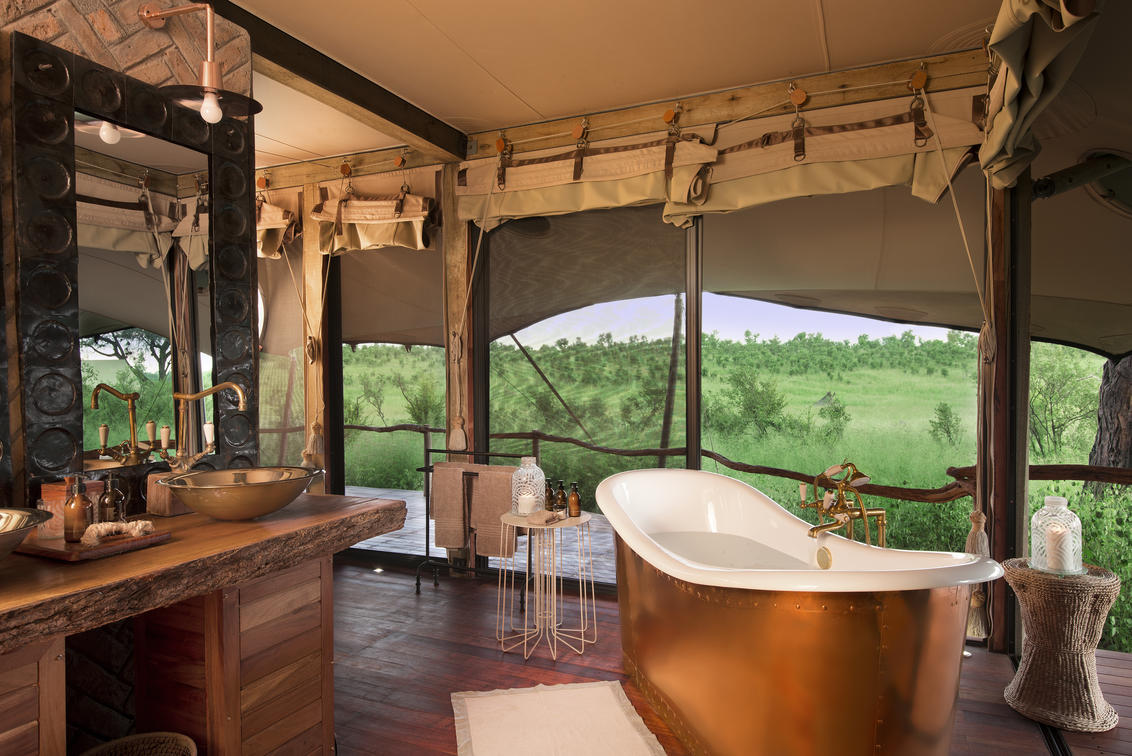 Copper bathtub in a luxury tented Camp in Zimbabwe