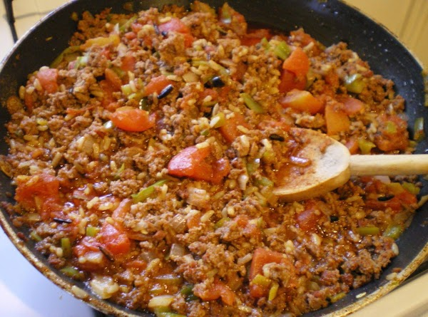 In a large pan cook ground beef and chorizo until browned.  Add onion...