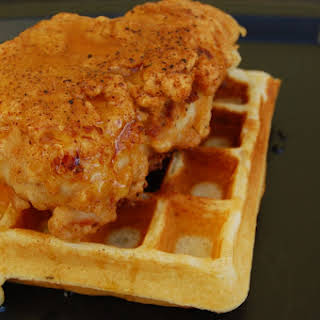 Sous Vide Batter-Dipped Fried Chicken with Honey and Waffles.