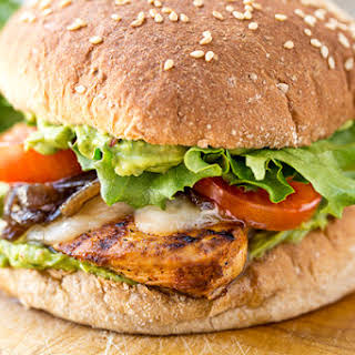 Spicy Guacamole Chicken Burger with Grilled Red Onions.