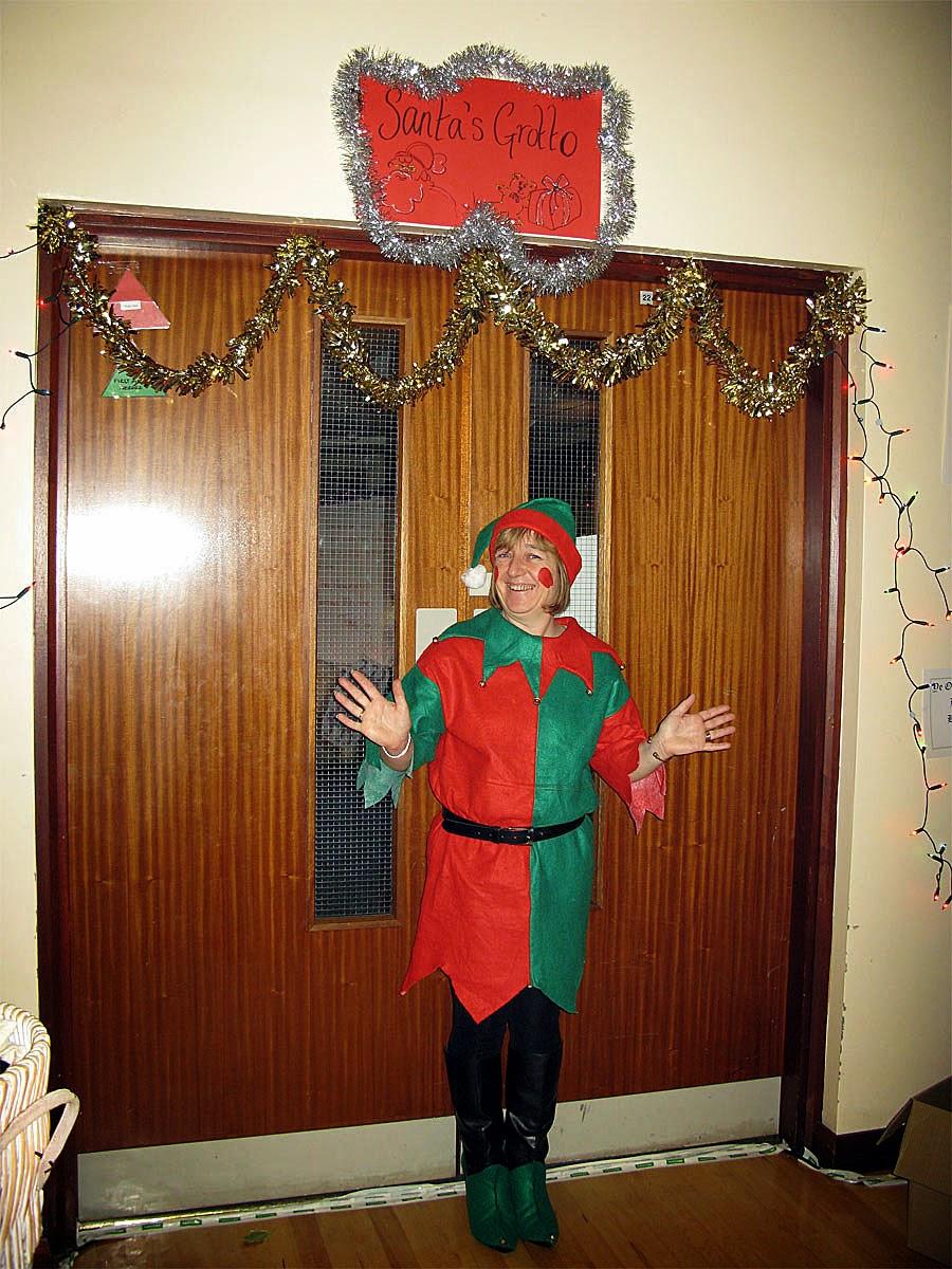 Photo: Santa's helper guarding the Grotto entrance