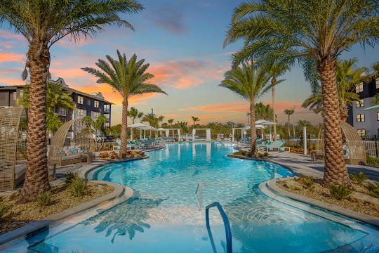 Botanic Waterside resort-style swimming pool at dusk