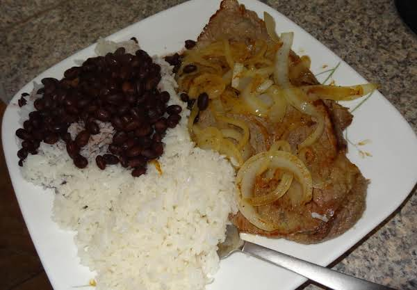 An Extremely Flavorful Meal For Any Fan Of Cuban Cuisine And Or Steak And Onions. This Recipe Makes The Perfect Rice And Beans That You Can't Seem To Find Outside Of Your Favorite Cuban Restaurant. One Bite And You'll Agree, This Is As Real As It Gets!