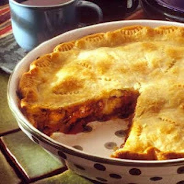 Let piecrusts stand at room temperature according to package directions. Lightly grease a 9-inch...
