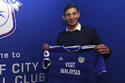 Argentine striker Emiliano Sala poses with the Cardiff City jersey after signing for the Wales club on January 20 2019.