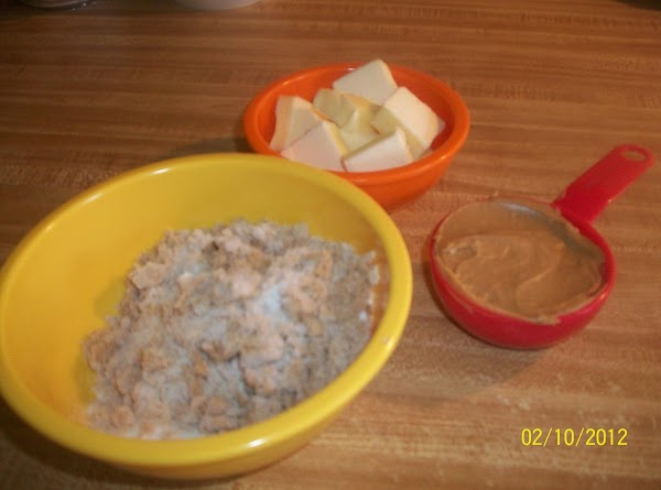 In food processor or large mixing bowl, cream together the butter, sugar, brown sugar,...