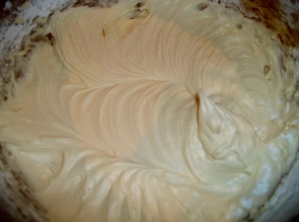 Frosting:Beat together butter, cheese, vanilla and add sugar. Mix until well blended.