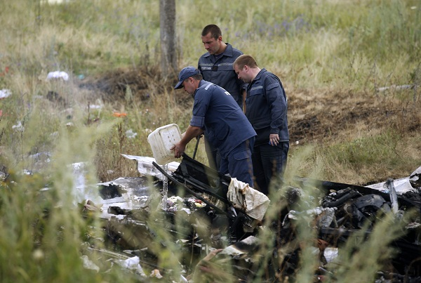 Members of the Ukrainian Emergencies Ministry work at the crash site of Malaysia Airlines Flight MH17 near the village of Hrabove in the Donetsk region of Ukraine in 2014.  Picture: REUTERS