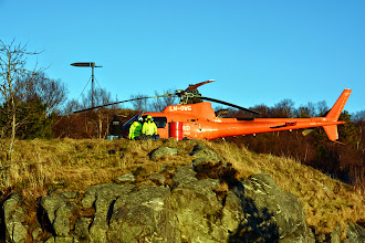 Photo: A helicopter being used to ferry concrete for the reconstruction of the path from the town to the lookout