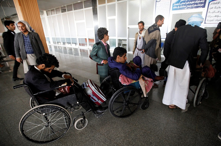 Wounded Houthi fighters wait at Sanaa airport during his evacuation from Yemen, December 3 2018. Picture: REUTERS/MOHAMED AL-SAYAGHI