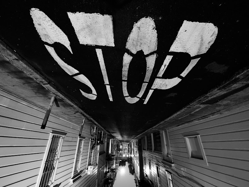 Photo: STOP! In the name of photography - take two!  I took this photo during a North Beach, San Francisco photowalk organised by +Thomas Hawk  a few weeks back, and at the time I wondered if it might look better upside-down... anyway, I posted the 'correct-way-up' version and moved on. But i've just now been browsing through my images and this version suddenly stood out at me - inevitably because the text is readable.  Which do you prefer? It's clearly upside-down, but somehow more fun. You can see the correct version earlier in my stream. or you can just turn your screen (or head) upside-down!  As for the technicalities it was taken with a Panasonic GX1 and 7-14mm at 7mm (14mm equivalent), then turned to B&W in photoshop with a boost in contrast.  PS -once again I'll admit I shamelessly plagiarised this location from +Karen Hutton !