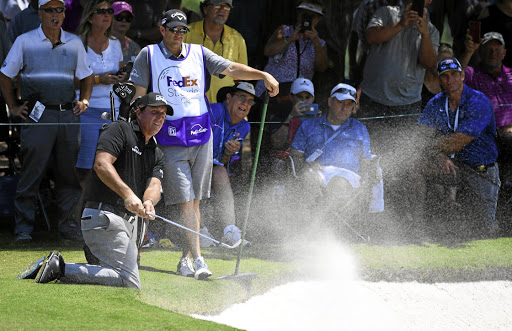 Chip and dip: Phil Mickelson, seen here on his knees at the recent St Jude Classic, hopes the Shinnecock Hills course at this week's US Open is presented fairly to all players. Picture: USA TODAY SPORTS