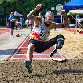 Gravity Prevails by Garry Dosa - Sports & Fitness Other Sports ( air borne, sports, jumping, long jump, outdoors, person, games, track and field, athletes, man, people, male,  )