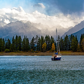 Lonely Boat by Richard Michael Lingo - Transportation Boats ( grand teton national park, lake, wyoming, boat, transportation )