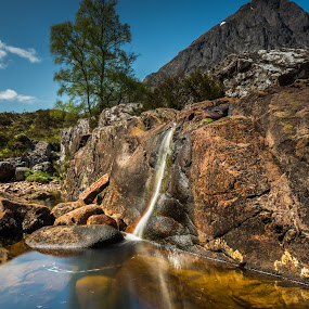 Waterfall reflection. by Haim Rosenfeld - Landscapes Mountains & Hills ( exposure, scotland, europe, mountain, colorful, waterfall, land, stone, reflections, rock, yellow, travel, north, landscape, adventure, sky, tree, kingdom, shadow, dreamlike, light, foreground, water, orange, united, uk, celtic, texture, colors, green, scottish, horizon, image, brawn, lake, scenic, highlands, photo, in, blue, outdoor, brown, scenery, stunning, britain )