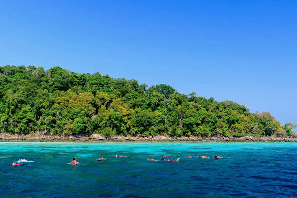 Snorkel in crystal clear water in the Surin archipelago