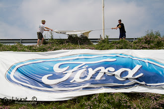 Photo: Brad & Andrew prepare to photo-bomb the Ford sign