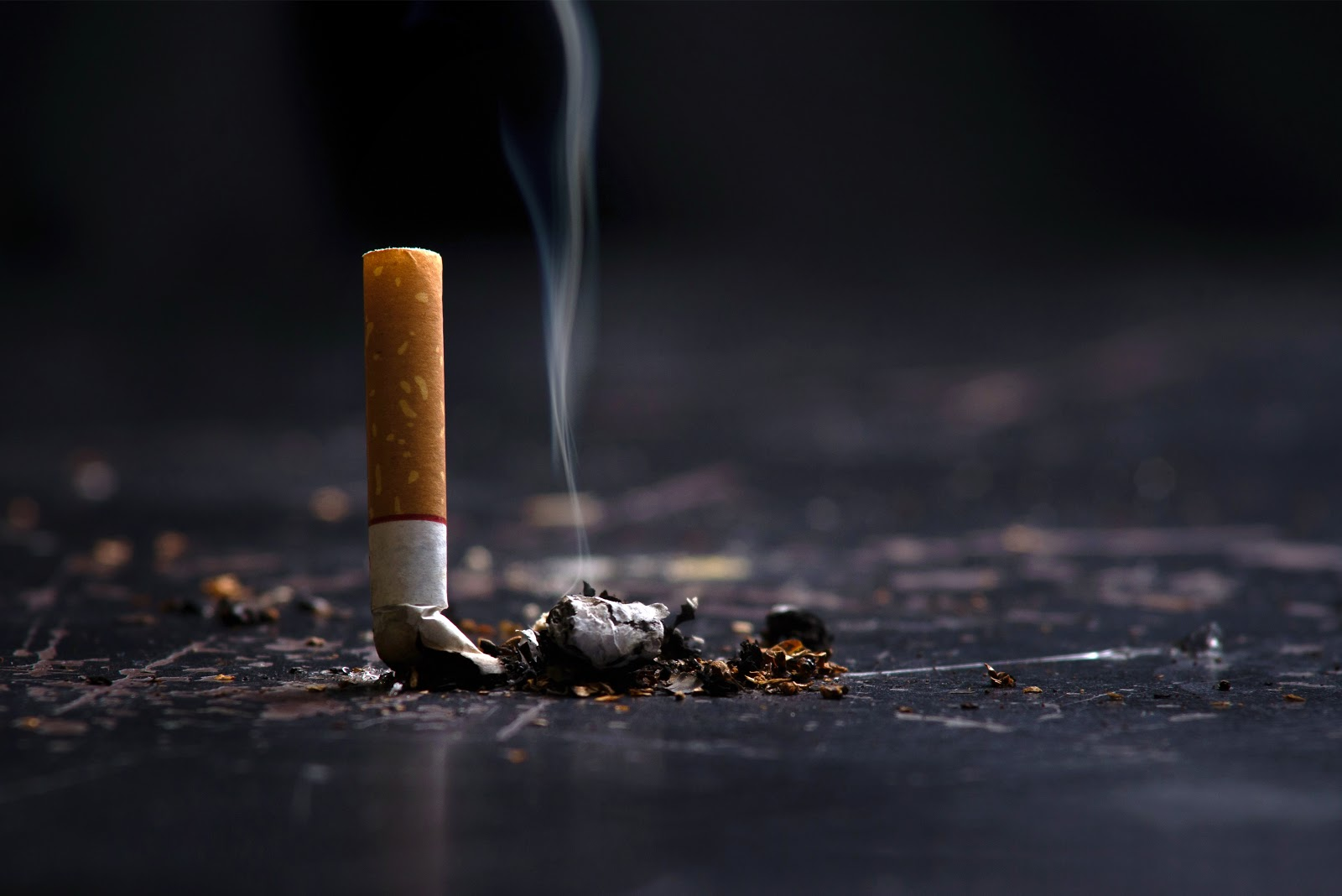 An image of a cigarette and the smoke and tar it produces which is inhaled when smoking.