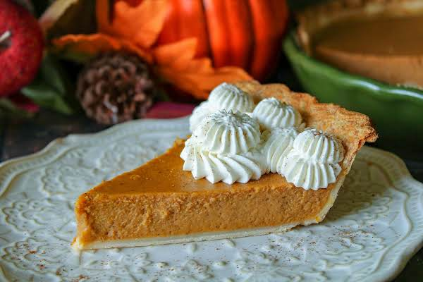 A Slice Of Apple Butter Pumpkin Pie With Whipped Cream.