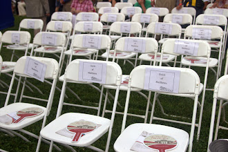 Photo: Dave Matthews (naturalized in 1980) was the speaker. Lots of seats reserved for his guests, including his Mom (also a naturalized US citizen).