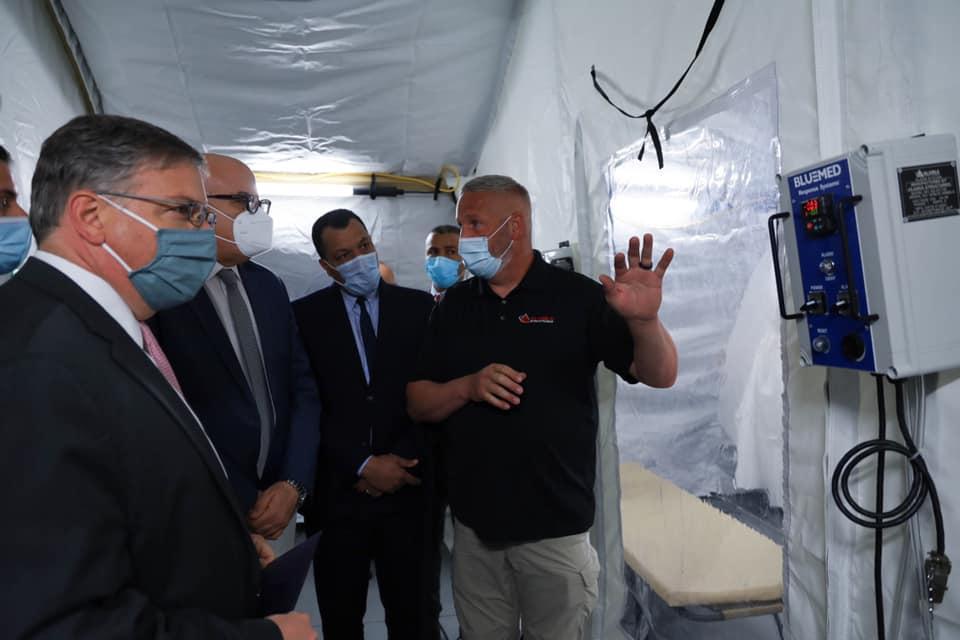 Alaska Structures Representative reviews negative pressure alarm to Tunis officials inside mobile field hospital