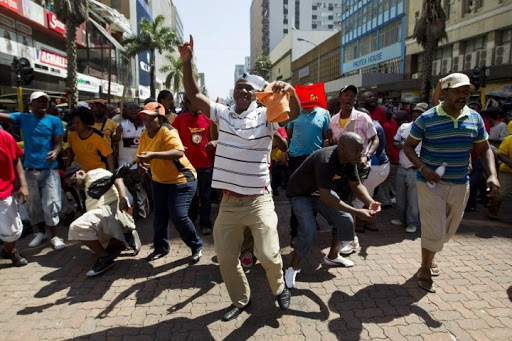Workers belonging to the South African Transport and Allied Workers Union (Satawu) march. Picture: REUTERS