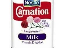 In bowl of blender, add evaporated milk,