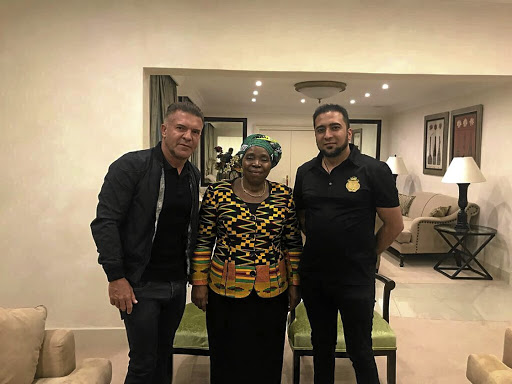 Nkosazana Dlamini-Zuma flanked by Adriano Mazzotti, left, and Carnilinx chief operating officer Mohammadh Sayed.