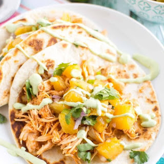 Slow Cooker Sriracha Chicken Tacos with Caramelized Pineapple Salsa.