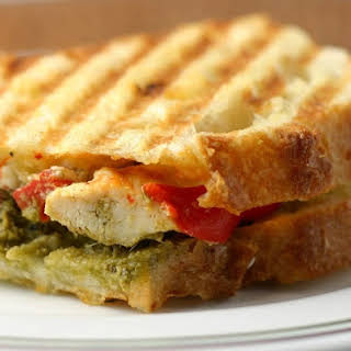 Grilled Chicken Panini with Roasted Red Peppers, Pesto and Garlic Herb Cheese.