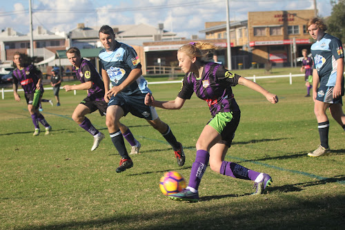 Crossroads Eleven FC's Clariese Ryman plays a through ball on Saturday in the Namoi Soccer League Narrabri derby. Left is Crossroads' Digby Nield and Narrabri FC's Danny Laws.