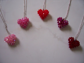 "Photo: Swarovski Crystal Heart. Size: 1"" x 1"" face and 1/2"" thick with 18"" chain. Color left to right: Rose light or Rose light AB, Rose or Rose AB, Siam light (red) and Fuchsia AB. $35.00 each."