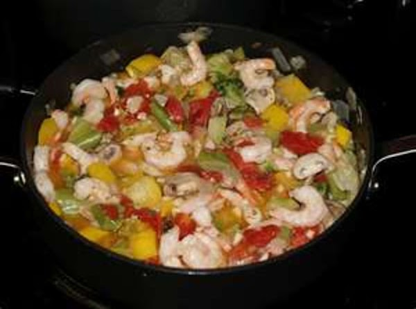 Heat oil in large nonstick pan over medium heat. Add carrots,bell pepper,zucchini,1 teaspoon garlic...