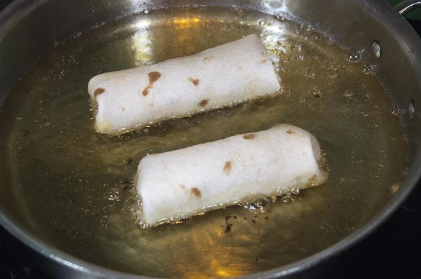 Place the tortillas in the sauté pan, seam side down, and then cook for...